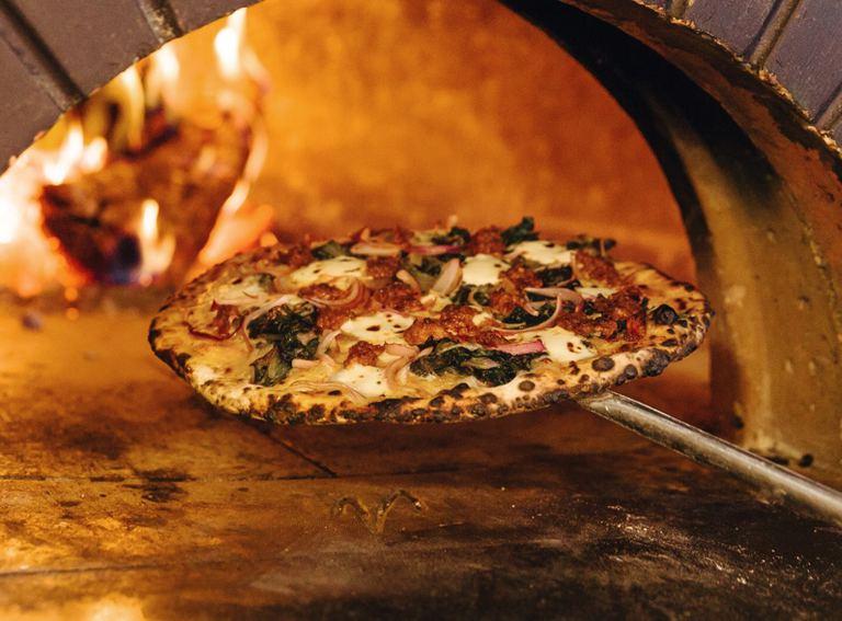 A seasonal wood-fired pizza