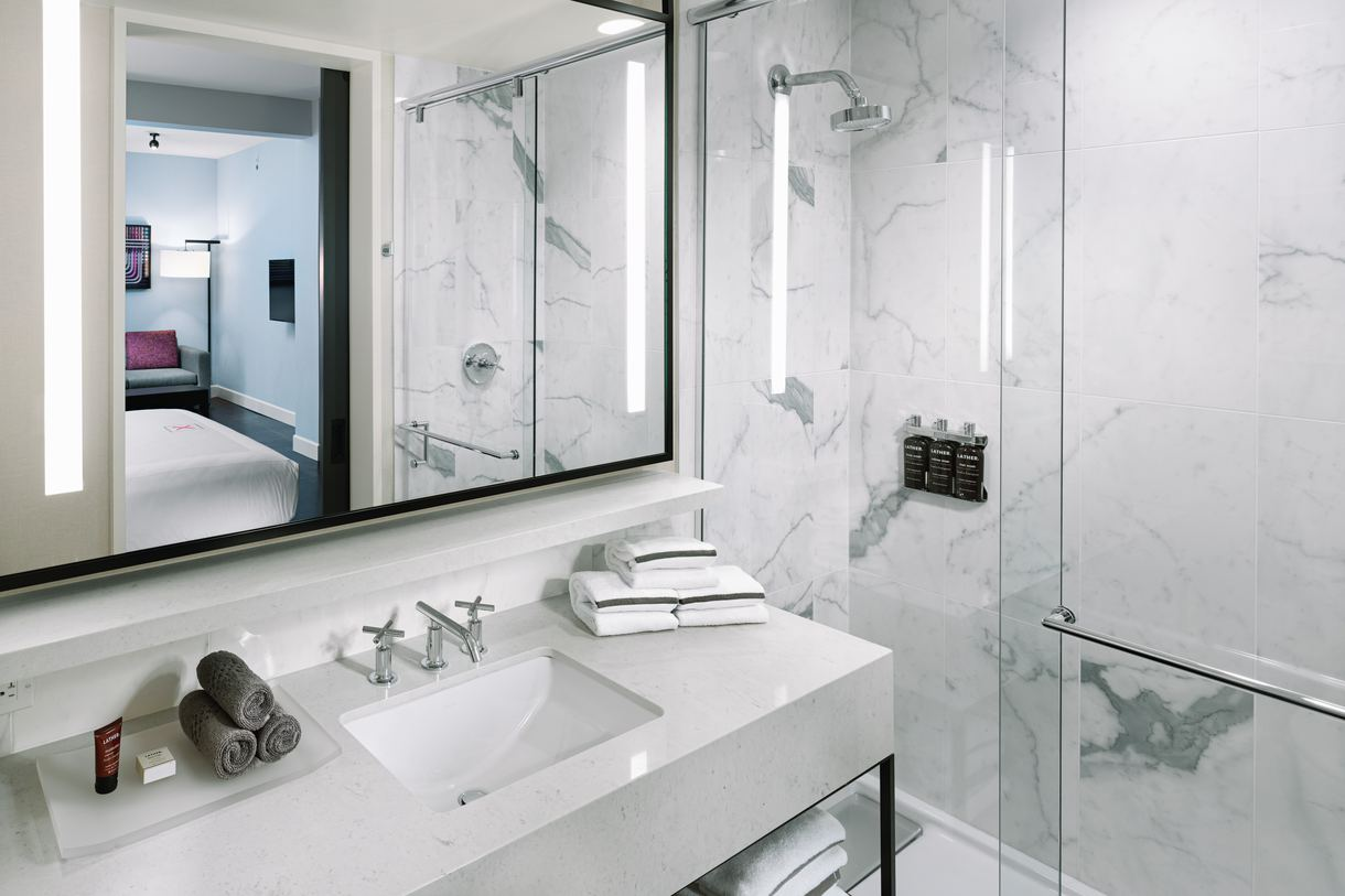 All guest rooms feature walk-in, marble showers