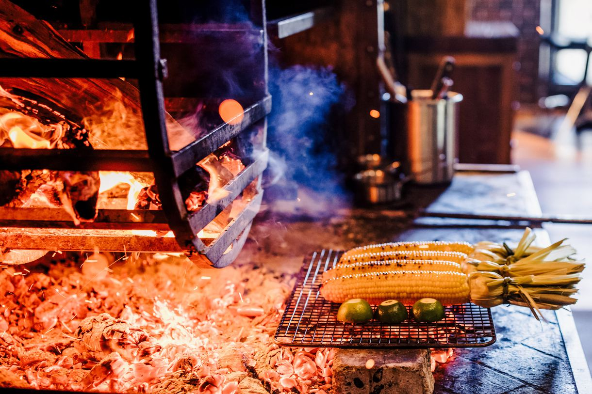 Fresh vegetables and fruits are also charred over the flames.