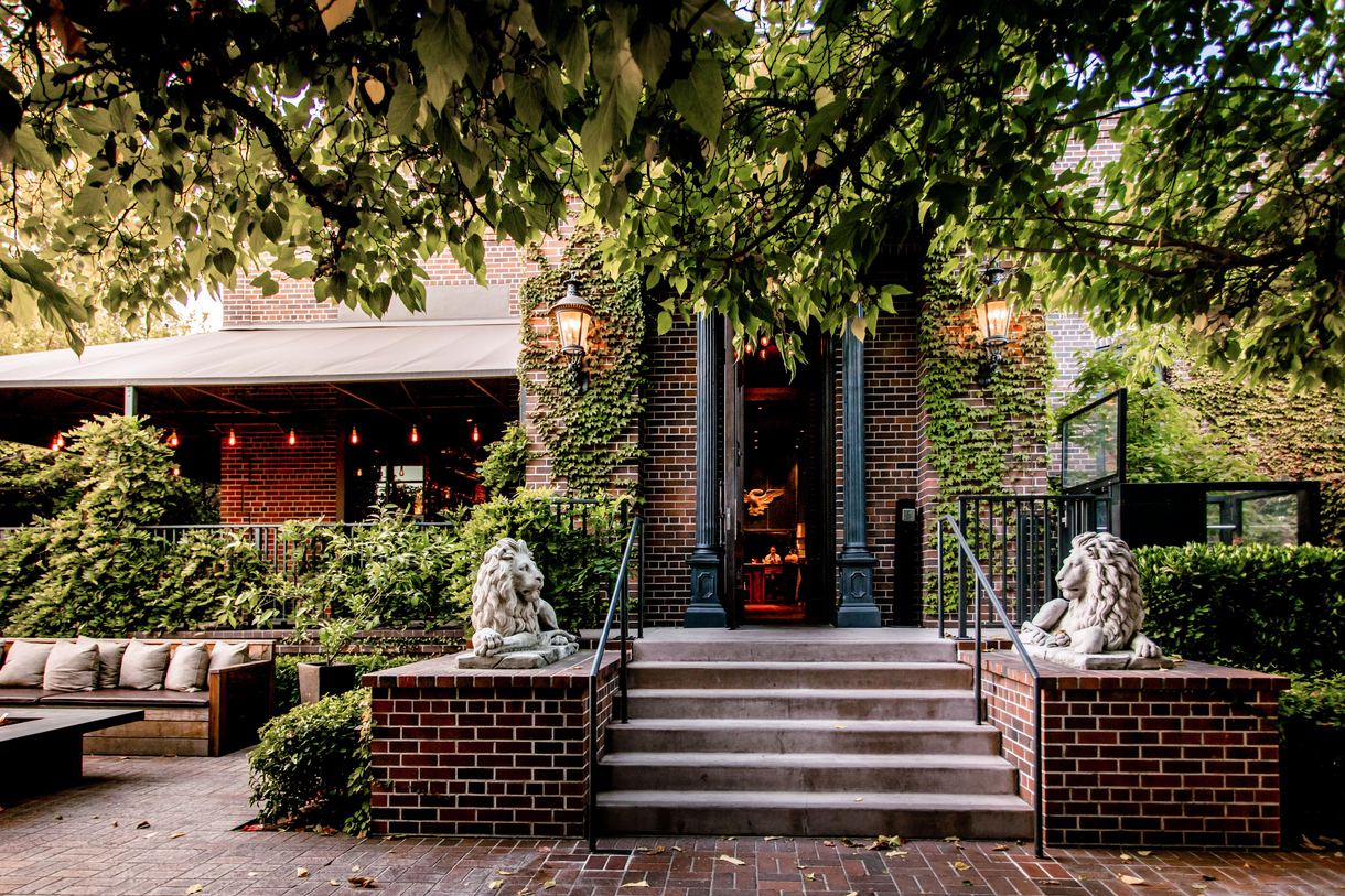 The ivy-covered facade beckons diners inside the charter oak.