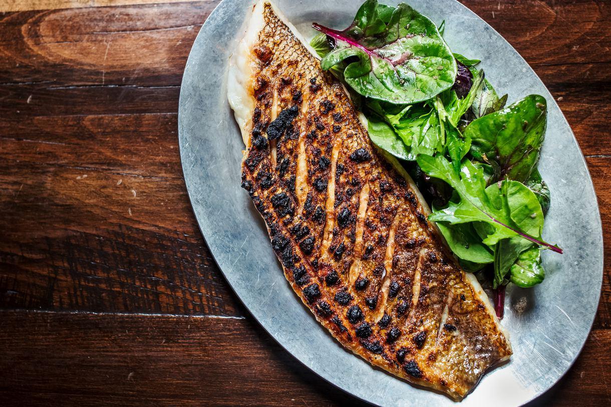 Wild-caught fish takes center stage alongside seasonal produce.