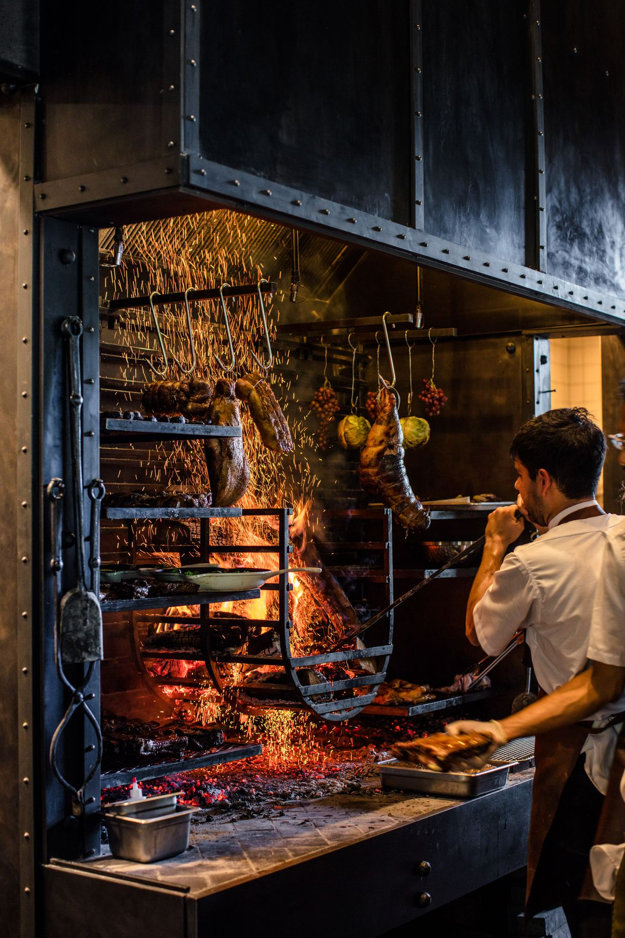 Locally sourced meats are roasted over an open hearth.