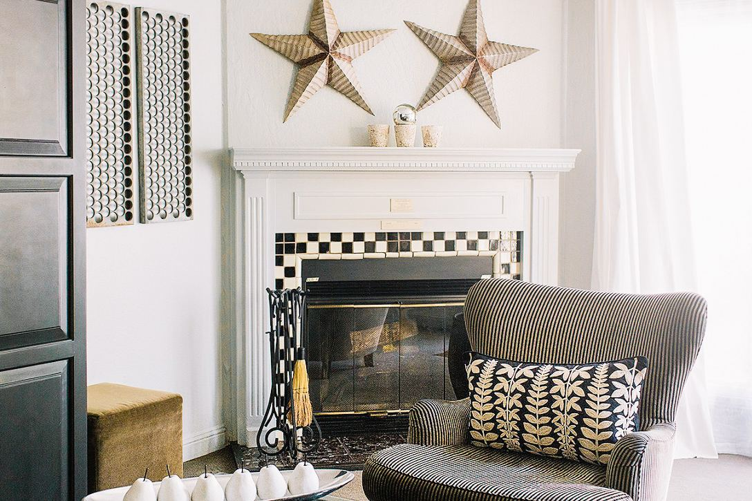 Cozy up by the fireplace in a rustic-chic guest room.