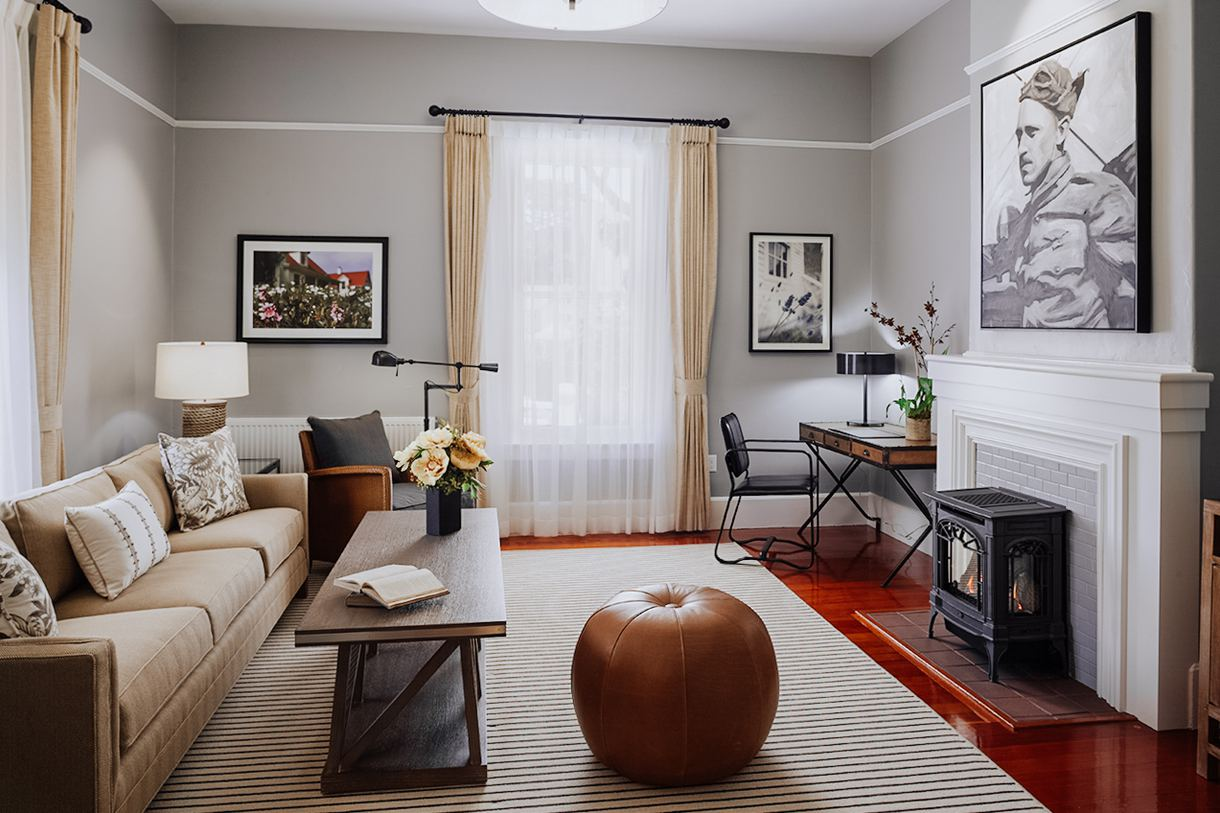 The thoughtfully appointed living rooms are graced by historic photographs.