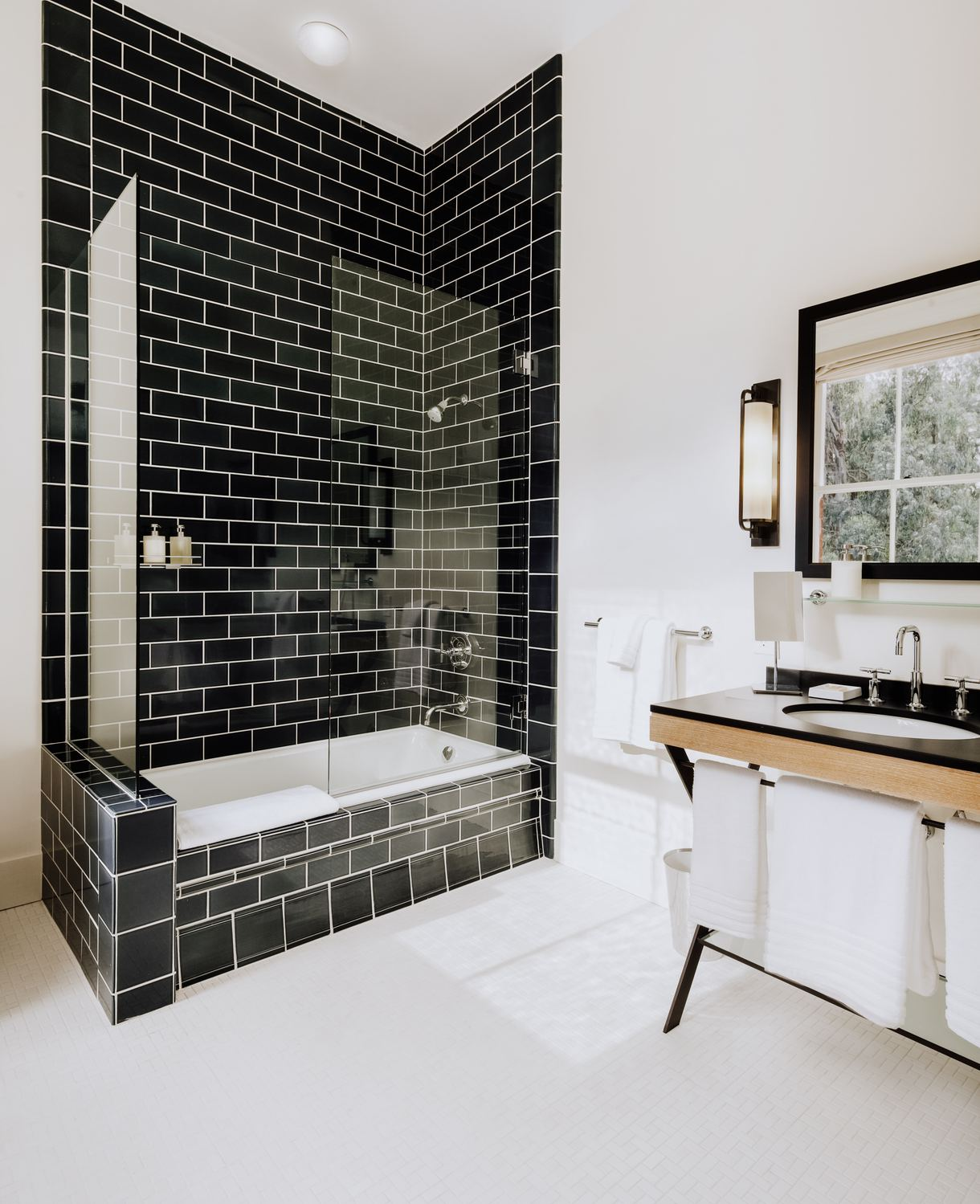 Locally made bath products are provided in each contemporary bathroom.