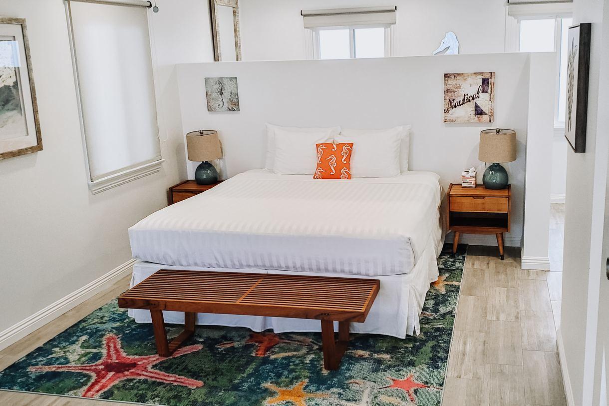 The charming room decor mirrors the resort's coastal surroundings.