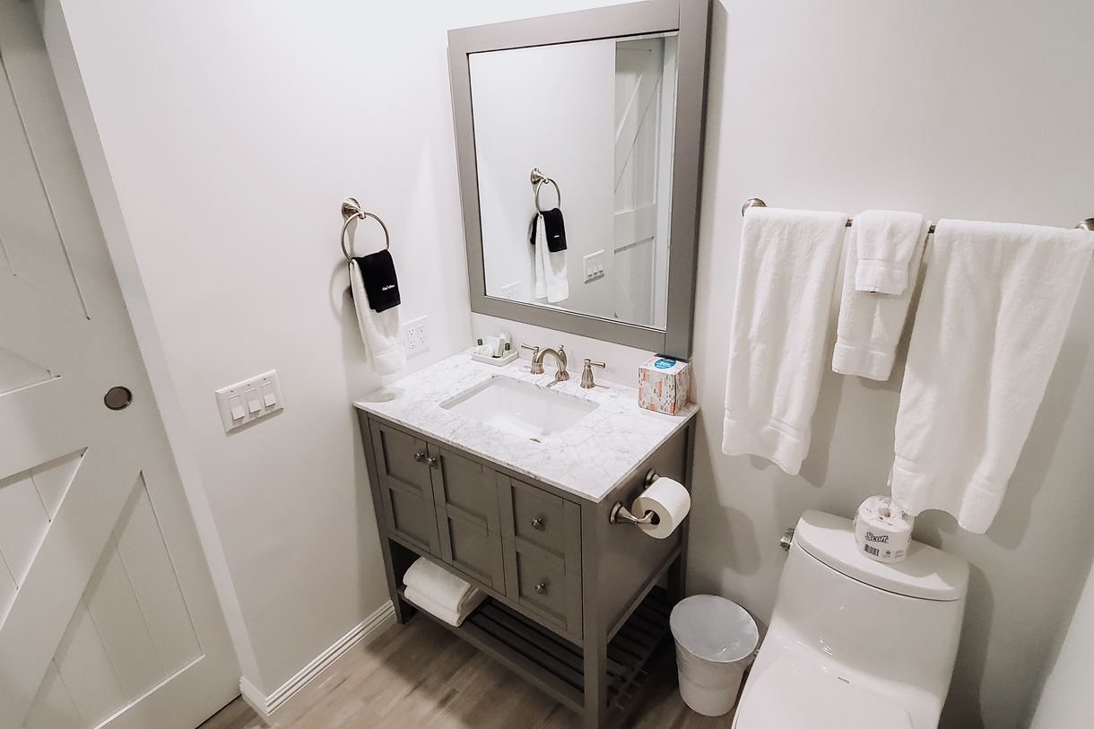 The cozy bathrooms provide a place to relax and unwind.