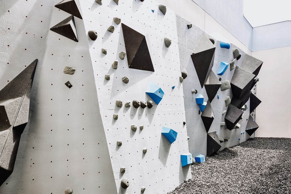 The gym also boasts a 40-foot-wide climbing wall.