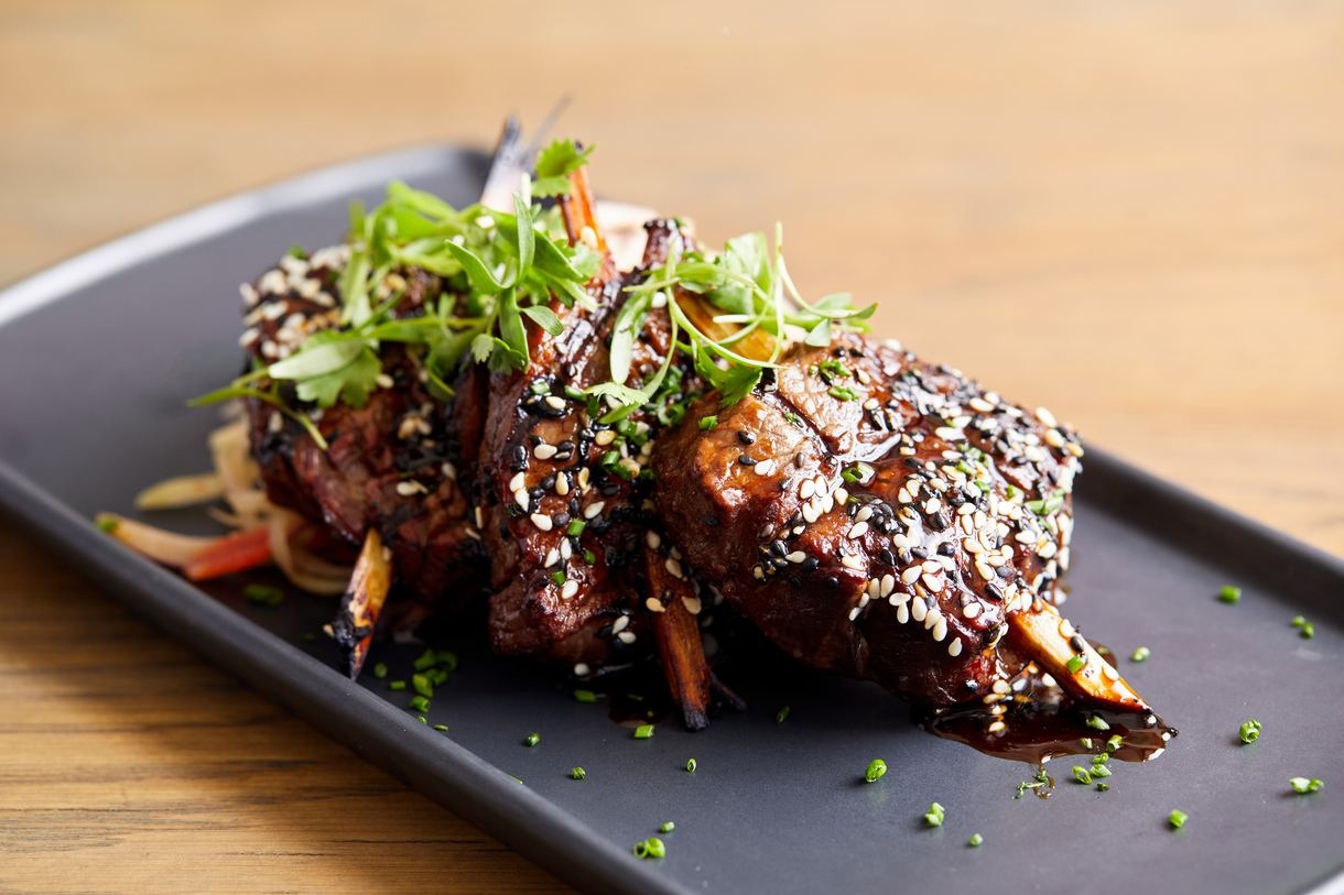 The sugarcane beef tenderloin is doused in Thai glaze and wasabi butter.