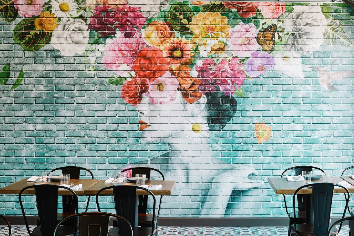 A colorful mural welcomes diners to Pacific Hideaway.