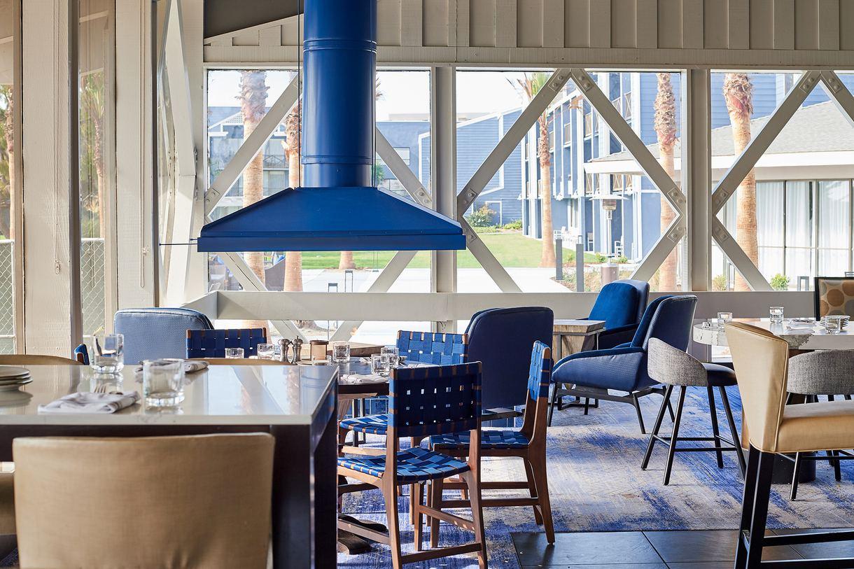 The restaurant interior mirrors its nautical surroundings. Photo by Peter Christiansen Valli.