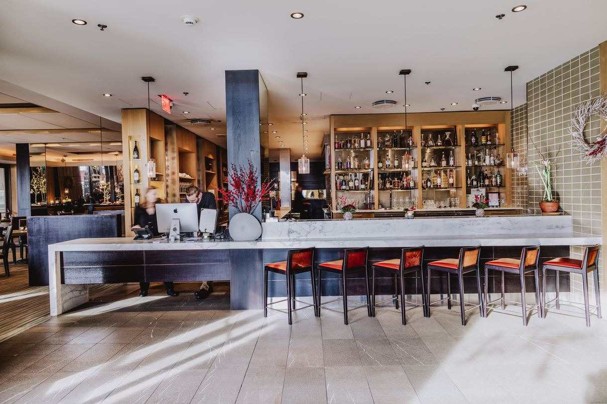 The bar offers a glimpse into the bustling open kitchen.