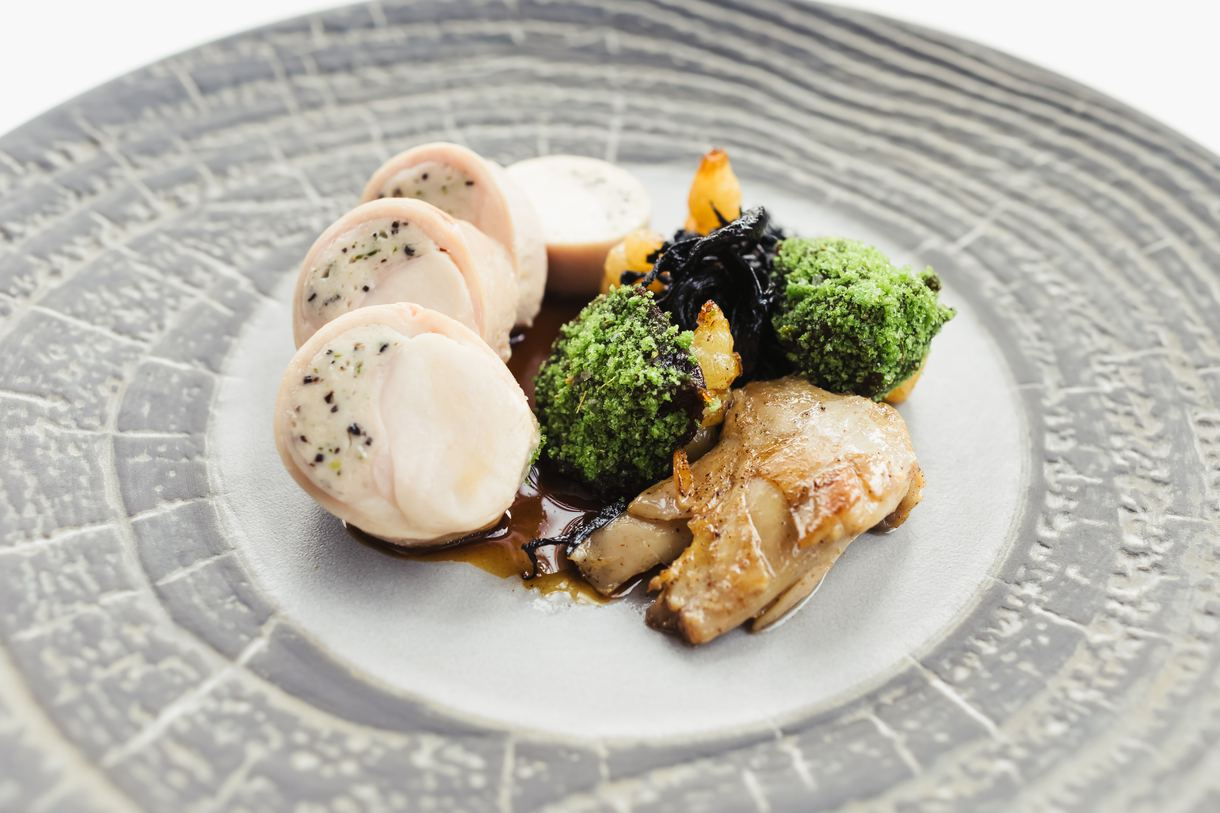 Rabbit loin ballotine intermingled with black trumpets and crosnes sassafras rabbit jus.